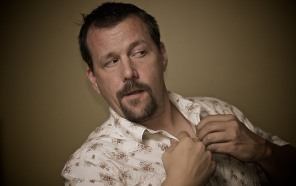 Portage man wearing floral shirt instead of plaid