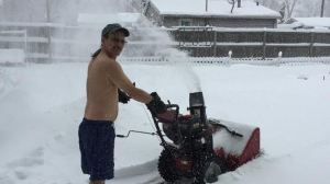 Portage man strips while blowing snow to out do neighbour